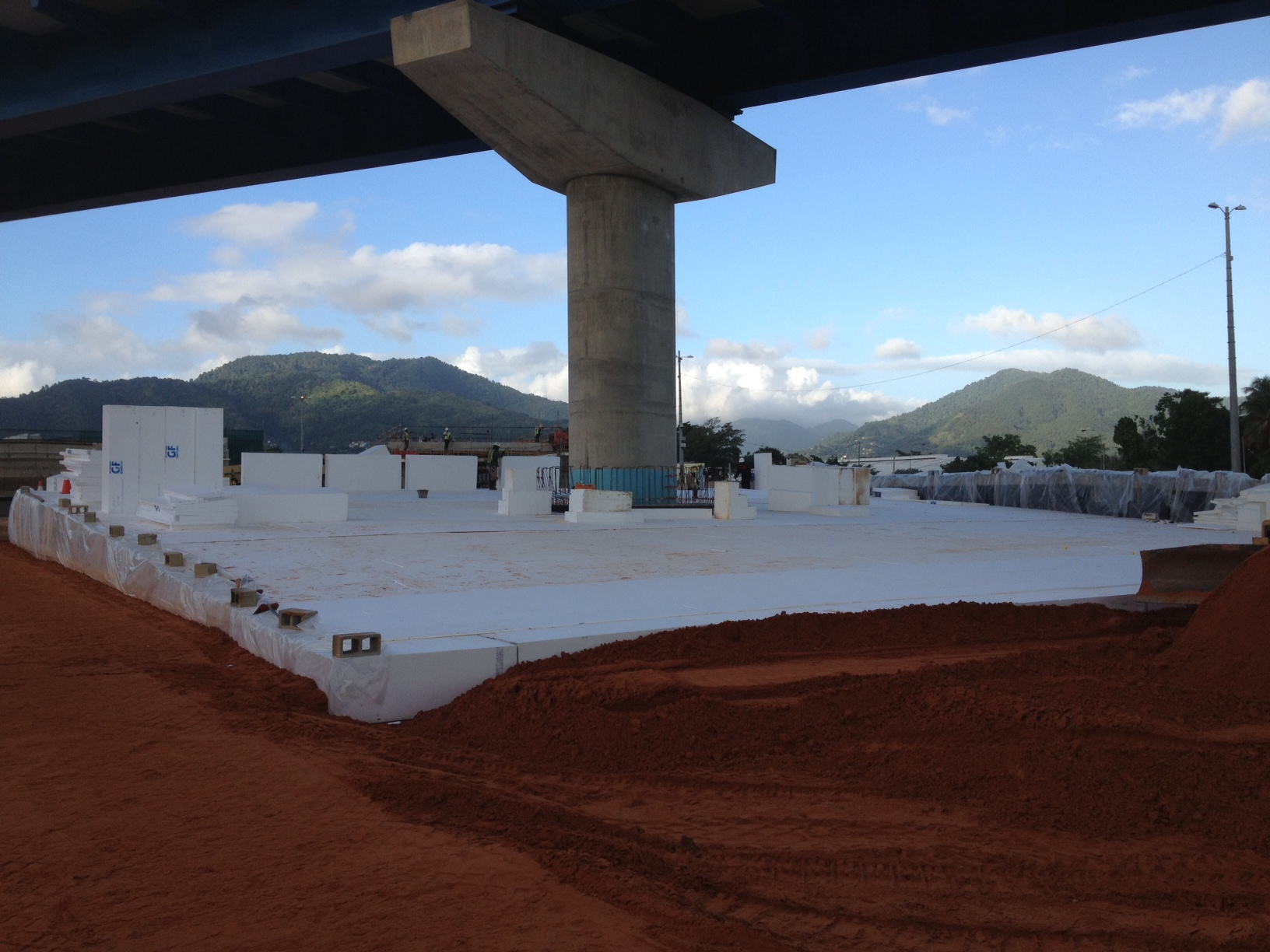 Working in the soft soils of Trinidad, the contractor specified EPS geofoam to reduce the load applied to the pile cap under the existing pier on this freeway interchange project.