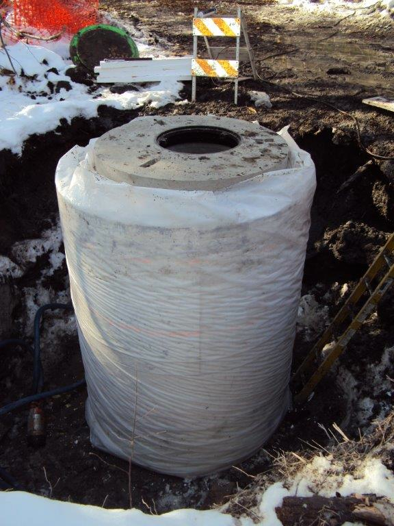 Geofoam solves manhole soil erosion displacement problem for Insulated concrete forms pricing