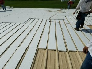 """Flute fill"" insulation helps reduce labor costs on recovers of standing seam metal roofs."