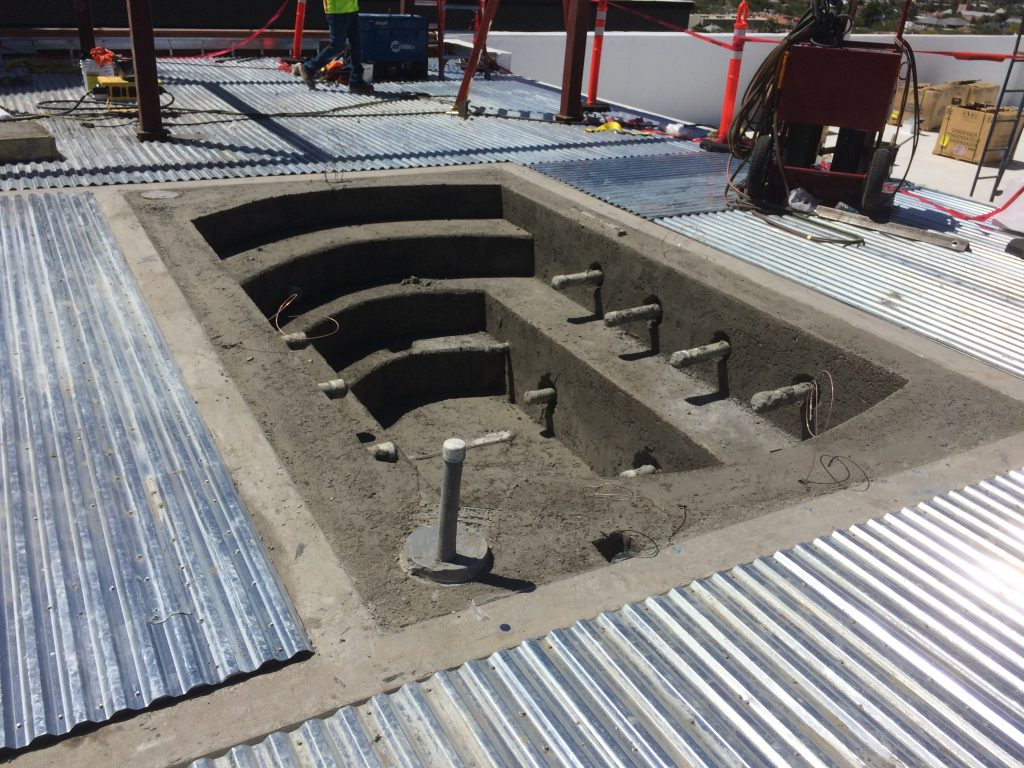 A pool and spa come together using Insulfoam GeoFoam as a fill... with mesh and finished off with shotcrete.